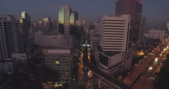 First Light Reflecting on Office Windows in Downtown Bangkok, Aerial Approach Stock Footage