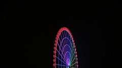 The magical attraction. Ferris wheel spinning at night Stock Footage