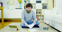 Man at home getting stressed out with bills and taxes Stock Footage