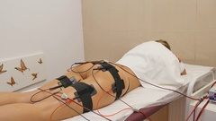 Beautiful woman getting electrostimulation therapy at beauty salon Stock Footage