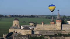 Hot air balloons flying over the fortress Stock Footage