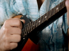 Close-up girls hand. Girl learning to play mandolin Stock Footage