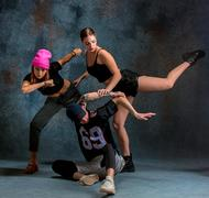 The two young girsl and boy dancing hip hop in the studio Stock Photos