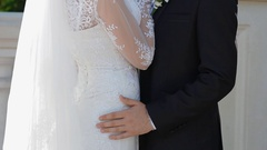 Man put hand on the bride's hip Stock Footage