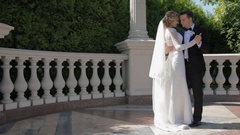 Bride and groom dance outdoor in sunny day Stock Footage