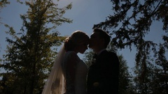 Bride and groom pose to photographer outdoor Stock Footage