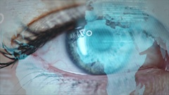 Macro of blue female eye with projection of animated world map.  Stock Footage