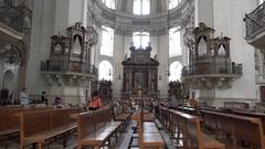 4k Baroque dome cathedral Salzburg Austria indoor tilt up Stock Footage