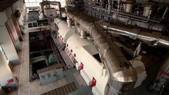 A turbine generator in the engine room of a nuclear power plant. HD Stock Footage