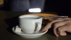 Young man stirring tea with spoon Stock Footage