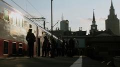 Passengers with bags walks by Yaroslavskiy train station Stock Footage