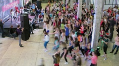 Crowd of people dance during Reebok Fitness training Stock Footage