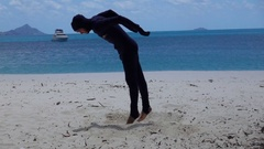 Young Man Perform Martial Art Move on the Beach, Slow Motion Stock Footage