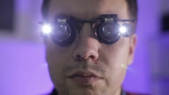 Terminator. Close up. The young man in the magnifying glasses. Stock Footage