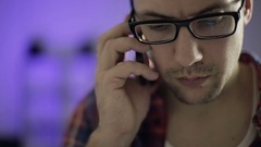 Young man with glasses hears the bad news over the phone. Stock Footage