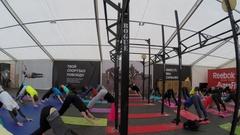 Yoga training of many people during Reebok Fitness training Stock Footage