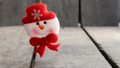 Snowman Toy on rustic wooden background. Christmas and New Year decoration Stock Footage