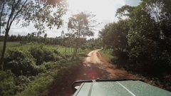 Driving through jungle road in Tanzania countryside with safari car, Timelapse Stock Footage