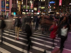 Crowd of people walking crossing street at night timelapse time lapse Stock Footage
