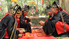 The old man preparing sacrificial offerings, Asia Stock Footage