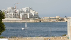 Boat -Yacht sails in the background of Valletta in Malta Stock Footage