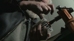 Repairer reeling copper wire on broken rotor, low angle view by Sheyno. Stock Footage