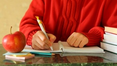 Student writes in notebook as Education concept Stock Footage