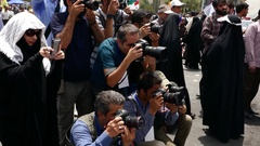 Photographers taking picture Iranian veteran handicap chanting down with Israel Stock Footage