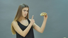 Hard choice: apple or burger, flustered girl decided to go on a diet Stock Footage