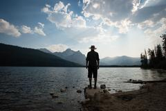 Rear view of man looking at view over Stanley lake, Idaho, USA Stock Photos