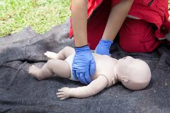 Paramedic demonstrate Cardiopulmonary resuscitation (CPR) on baby dummy Kuvituskuvat