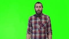 Young bewildered man in checkered shirt Stock Footage