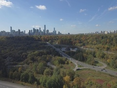 Don Valley Parkway overlooking downtown Toronto in Autumn aerial Stock Footage