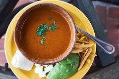 Overhead view of bowl of fresh soup with herb garnish, Antigua, Guatemala Stock Photos