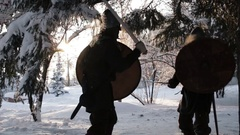 Medieval warriors fighting in a winter forest with swords in armor Stock Footage