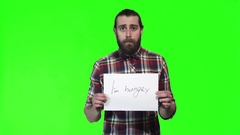 Bearded man hold i am hungry sign Stock Footage