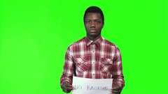 Young african man holds sign no racism Stock Footage