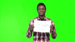 African man holds up happy sign Stock Footage
