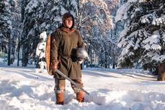 Warrior with swordin the winter forest in historical armor Kuvituskuvat