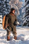 Medieval warrior in the winter forest Kuvituskuvat