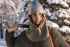 Portrait of a medieval warrior in the winter forest in historical armor Kuvituskuvat
