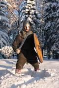 Swordsman in the winter forest in armor Kuvituskuvat