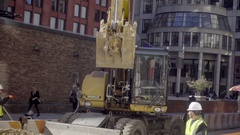 Construction digger on street outside NYU in Greenwich Village NYC Stock Footage