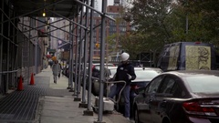 Construction worker with white hardhat using rope on scaffolding NYC Stock Footage