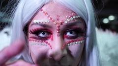 Close-up of girl dancer in makeup Halloween in the underground parking Arkistovideo