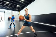 Male basketball player practicing aim on court Stock Photos