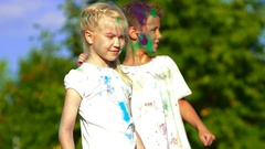 Close-up of children throwing holy powder at each other Stock Footage