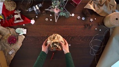 Woman opens paper parcel with Christmas cookies Stock Footage