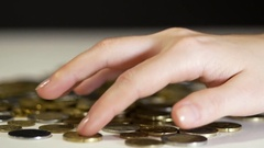 Female hand counts the coins on the table Stock Footage