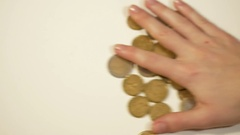Female hand rakes up coins Stock Footage